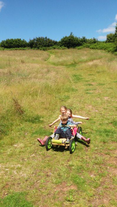 Children on a Go Kart at Brownscombe in Devon UK