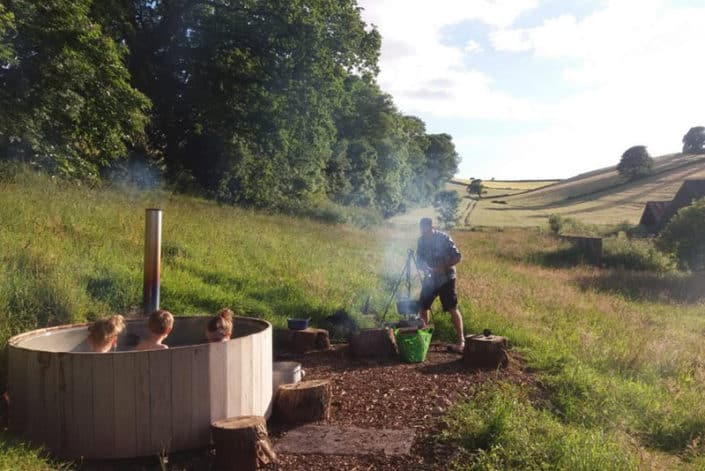 Family fun in the hot tub glamping uk