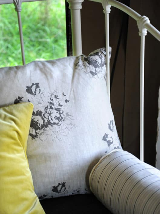 Ian Mankin cushions piled next to cool linen and velvet cushions