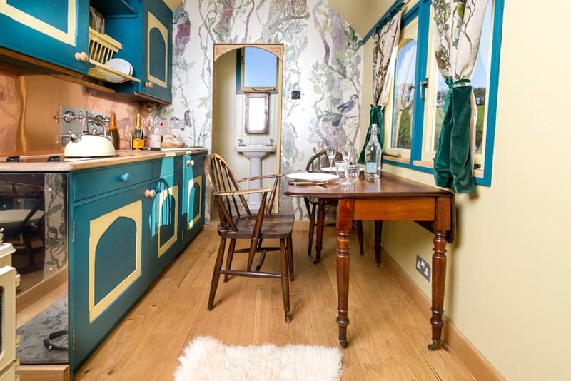 The kitchen and dining area inside the Tabernacle at Brownscombe Luxury Glamping UK