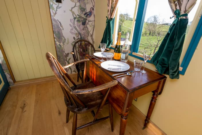 Laid table and chairs inside the Tabernacle at Brownscombe Luxury Glamping in the UK