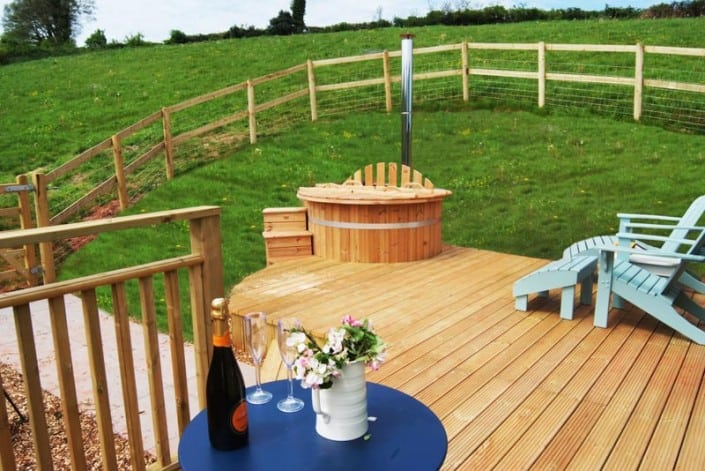 The decking, chairs and hot tub outside the Tabernacle at Brownscombe Luxury glamping in South Devon