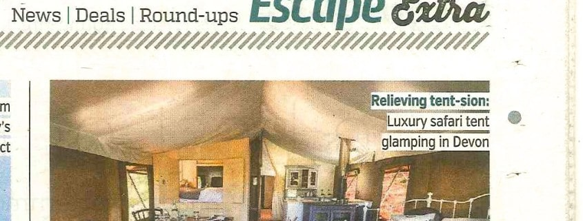 A newspaper cutting showing the inside of a Brownscombe safari tent taken from The Metro newsapaper's 2015 glamping feature