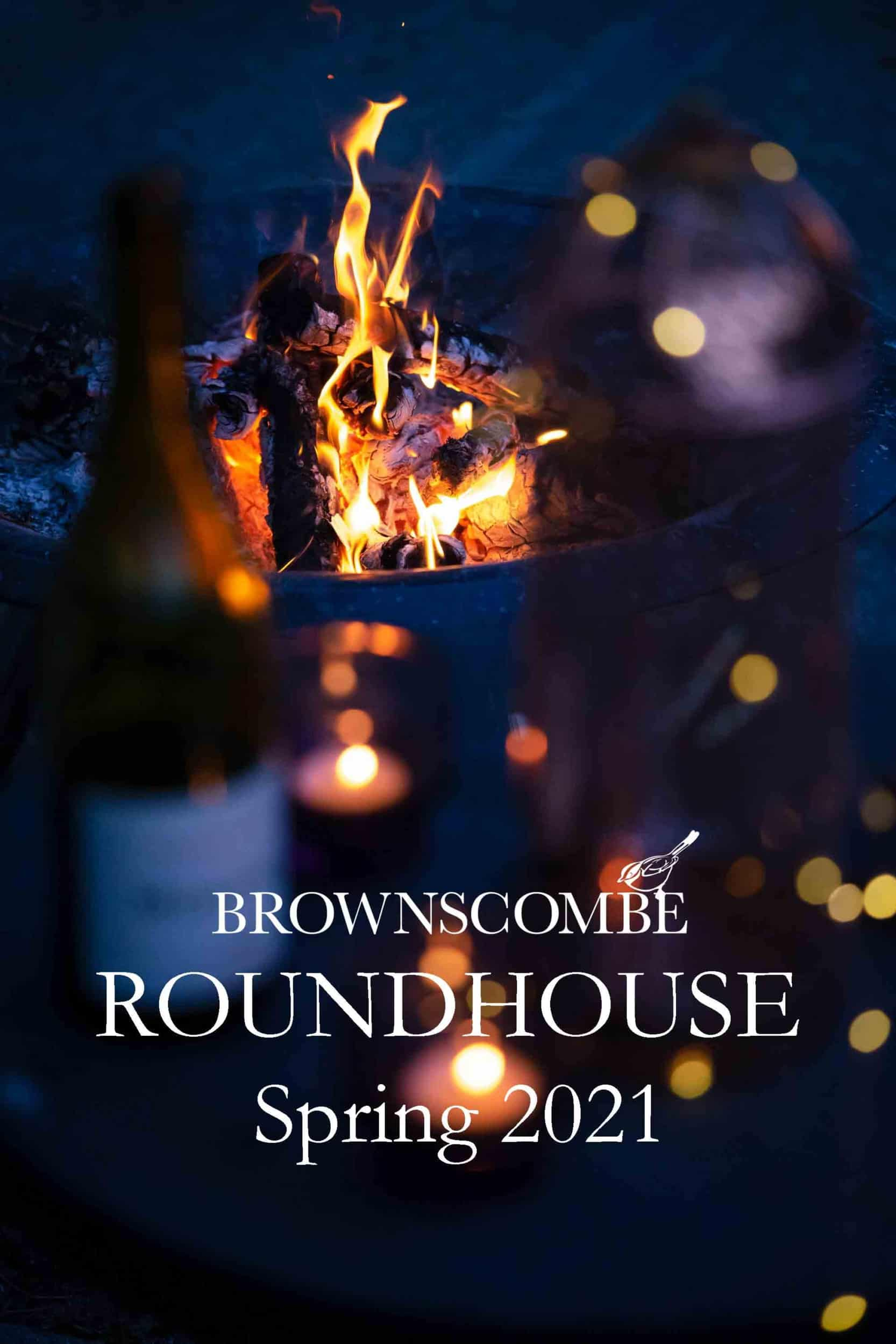 A bottle of wine in front of a firepit Brownscombe Roundhouse Spring 2021